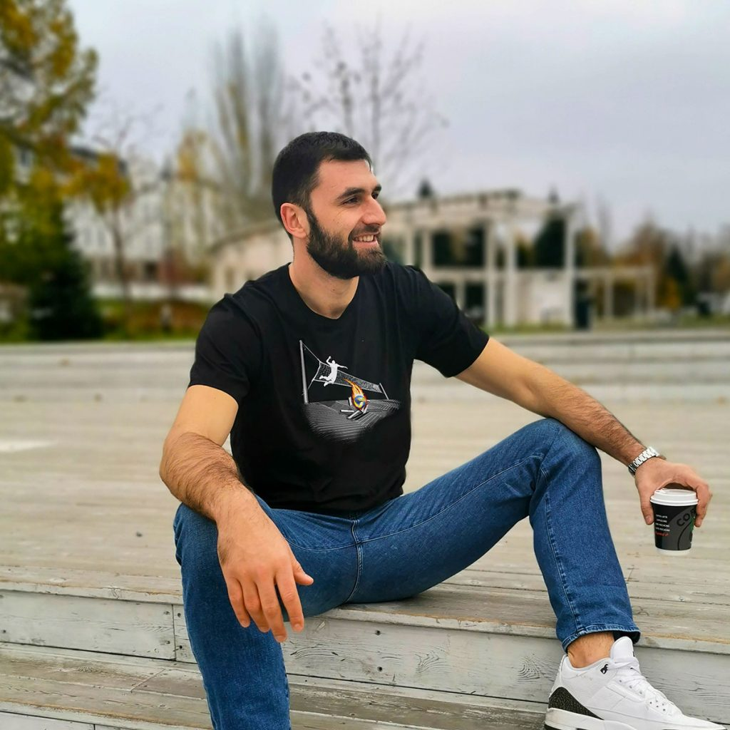 Tsvetan Sokolov wearing a black sports T-shirt with a volleyball graphic on it.